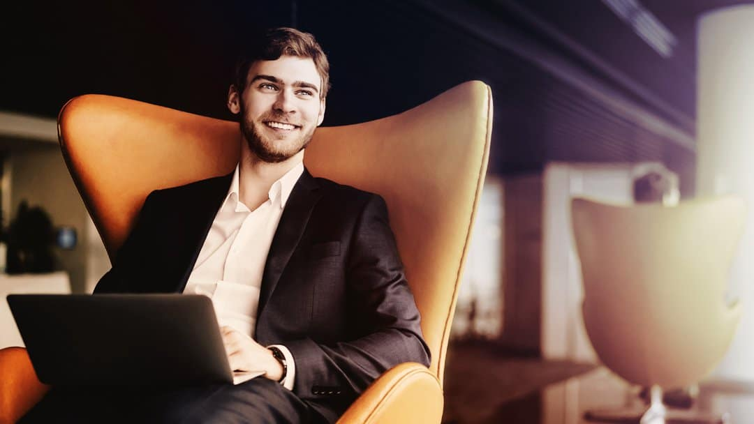 Happy business person in chair