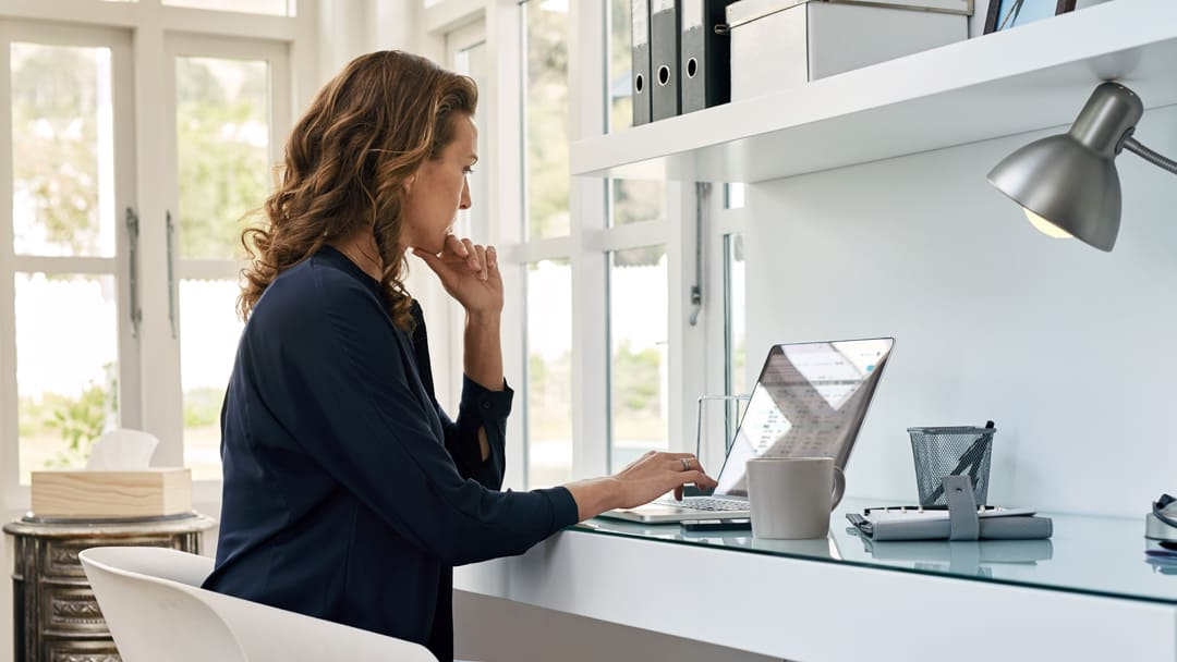 A woman works from home on a laptop computer.