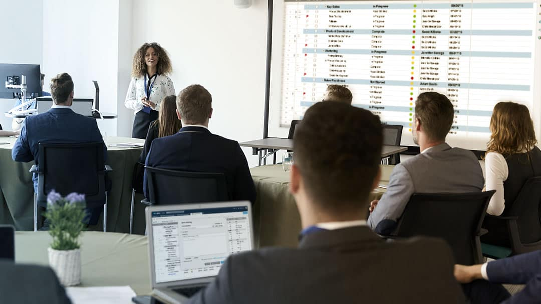 instructor teaching business professionals how to use Smartsheet