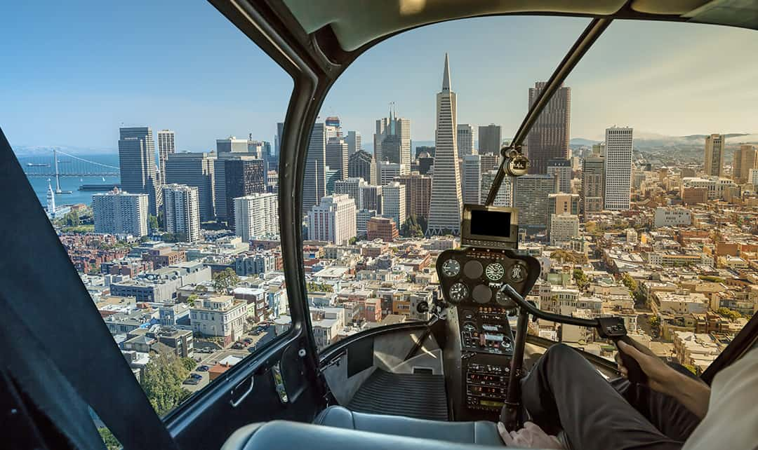 Point of view from inside a helicopter as it approaches downtown San Francisco