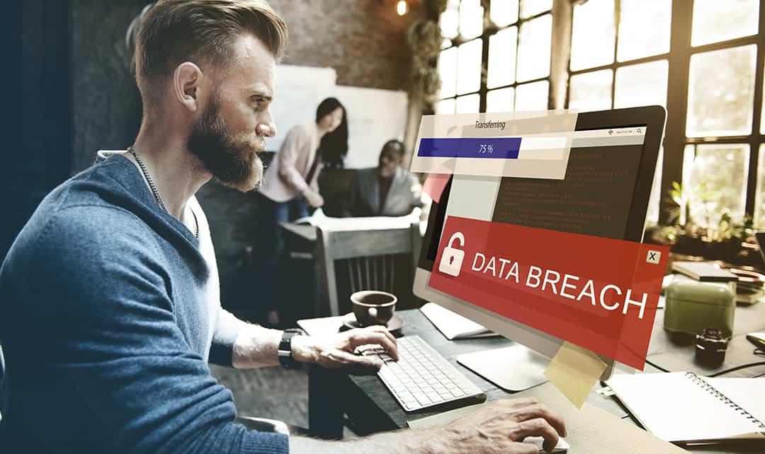 A man sees a data breach alert on his computer
