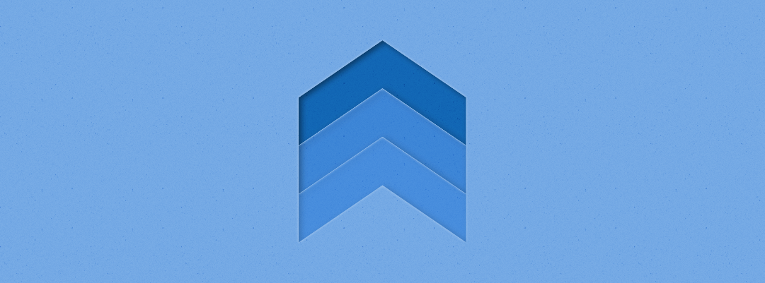 An image of three arrows pointing up, layered one on top of the other, with the top-most arrow in dark blue