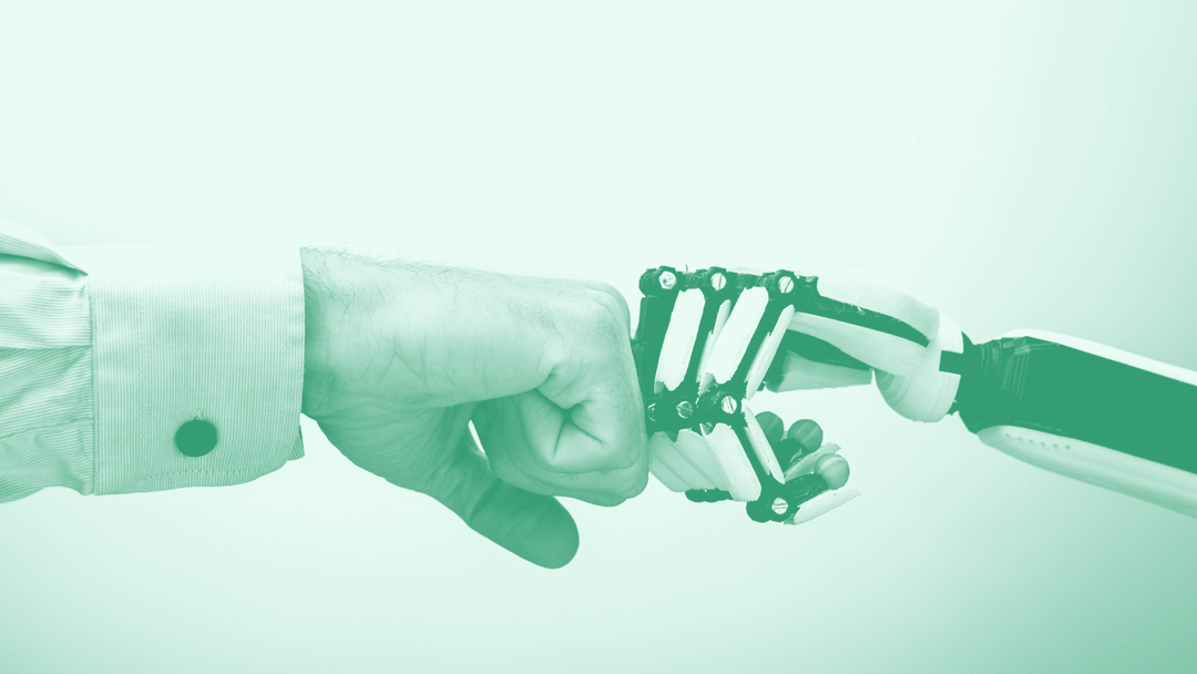 Human and robot fist bump