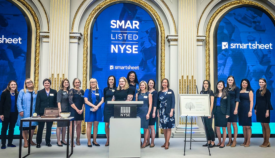 A photo of women who work at Smartsheet during the company's IPO event at the New York Stock Exchange.