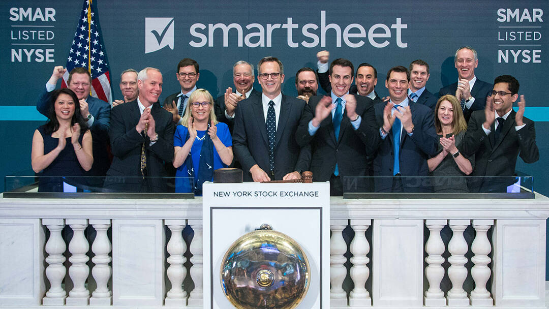 Smartsheet management and board members ringing the bell at the New York Stock Exchange