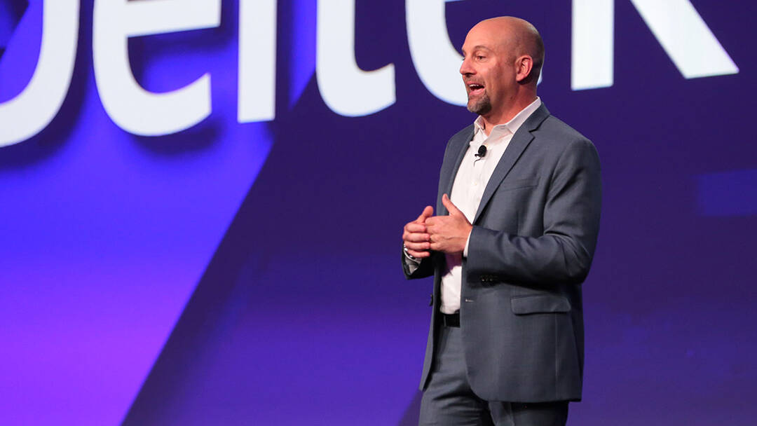 Mike Robbins delivers a keynote at a corporate event