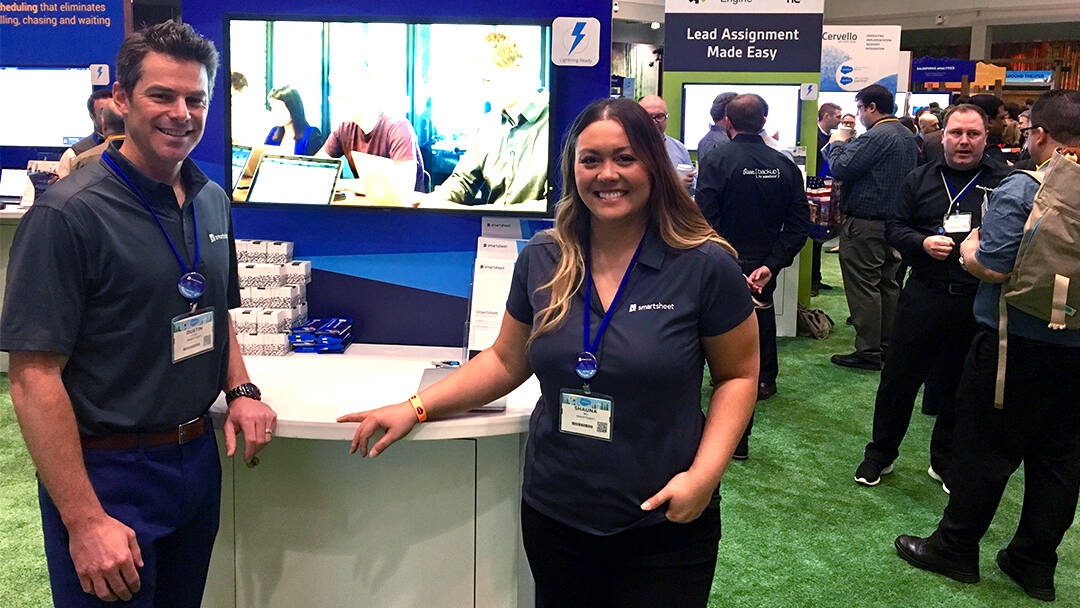 smartsheet employees at a trade show