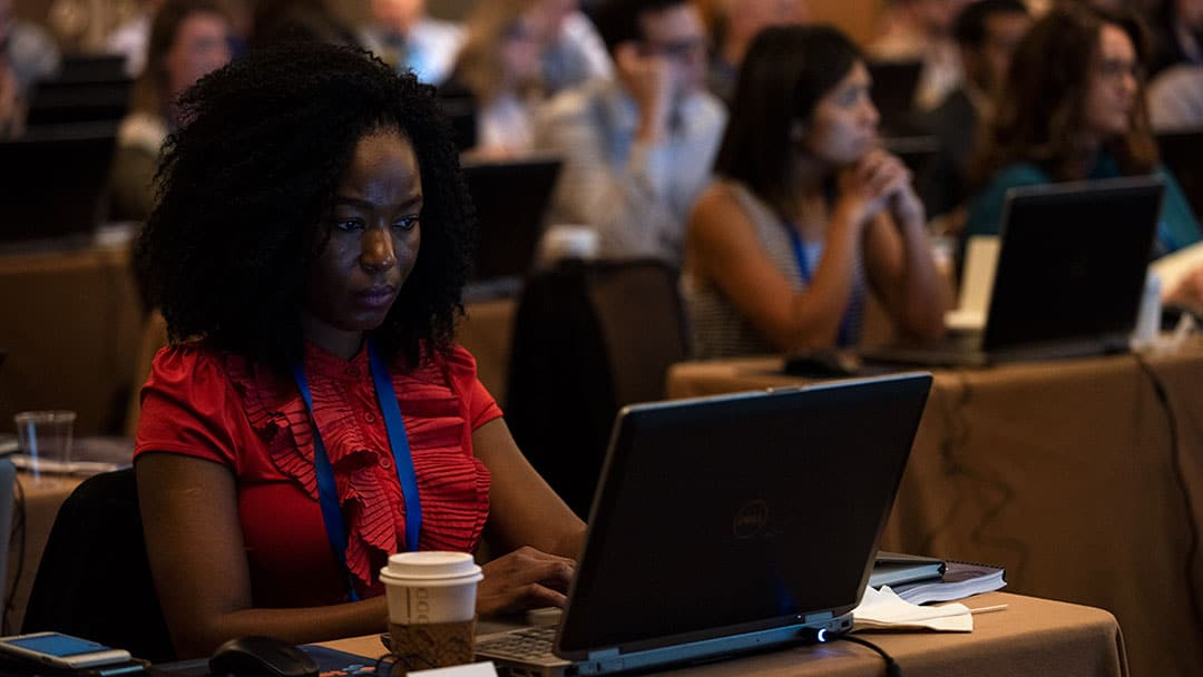 A woman works on a laptop at Smartsheet ENGAGE'18