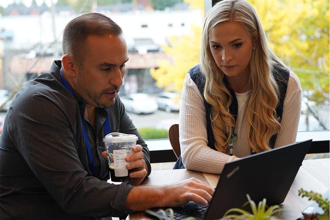 A Smartsheet employee helps a customer