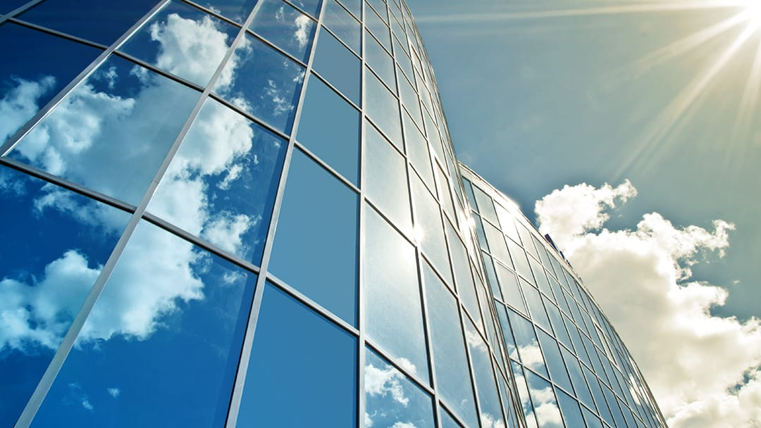 Office building with clouds