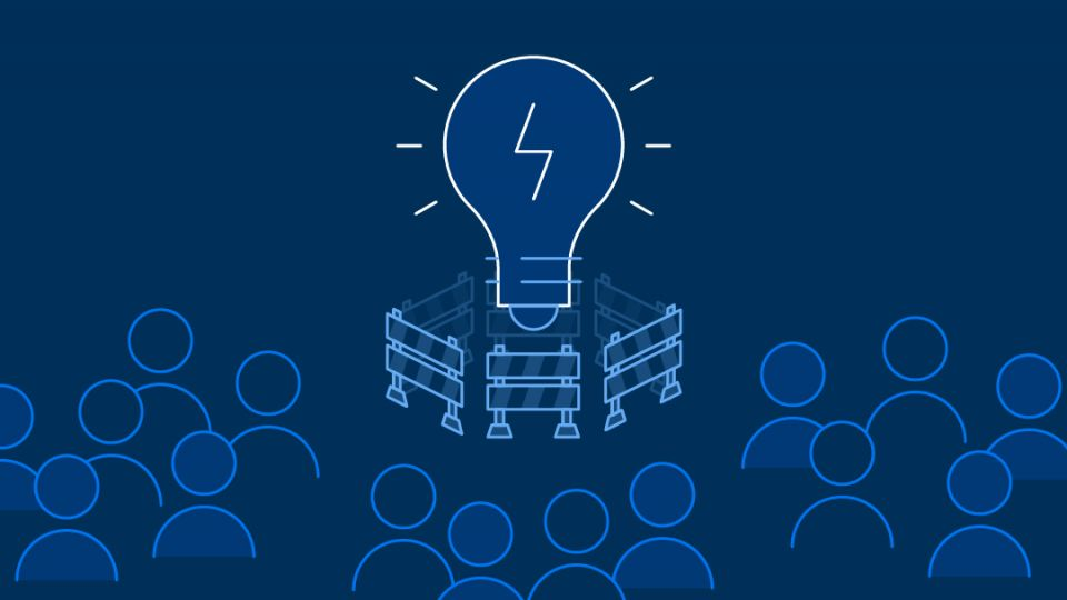 Simplified graphic shows a crowd of people and a light bulb